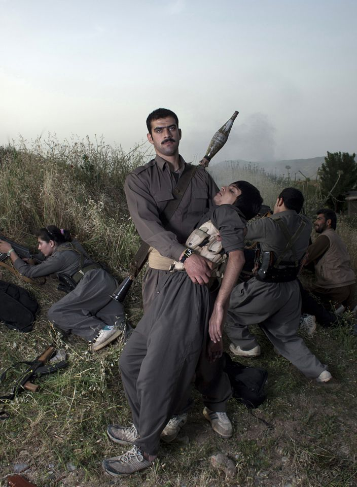 Theater of War, photographs with a group of Iranian-Kurdish guerilla fighters, Lambda print, 100 x 73 cm, Iraq, 2011-2012, Edition 2/9